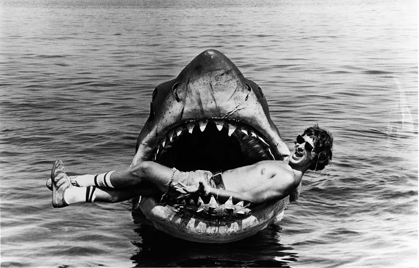 Steven Spielberg poses inside the mouth of Bruce the shark on set of Jaws